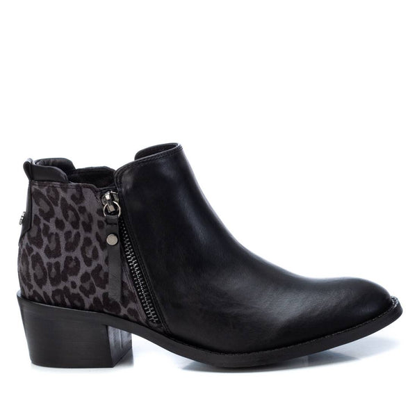 Beautiful ankle boot from fashion brand XTI. Low block heel with gorgeous print dtail on the heel and outside zip detail. Perfect under skinny's or a skirt. Available from www.moransshoes.com