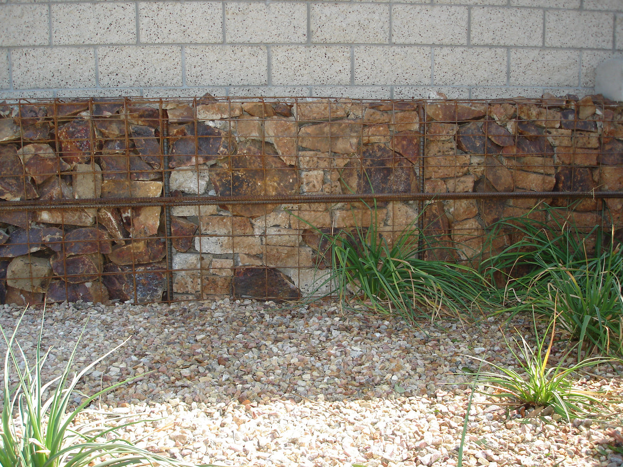 Gabion Stone Wall along with decorative stones with plants