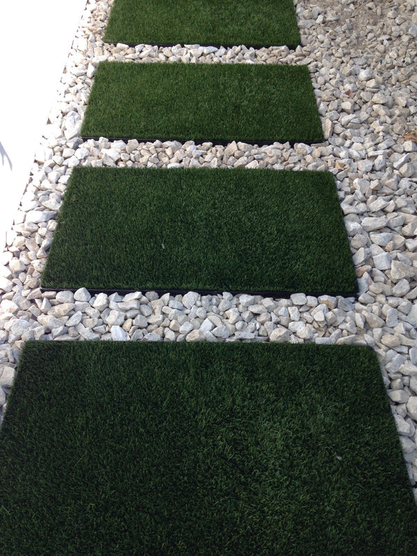 White gravel in a pathway application with artificial grass