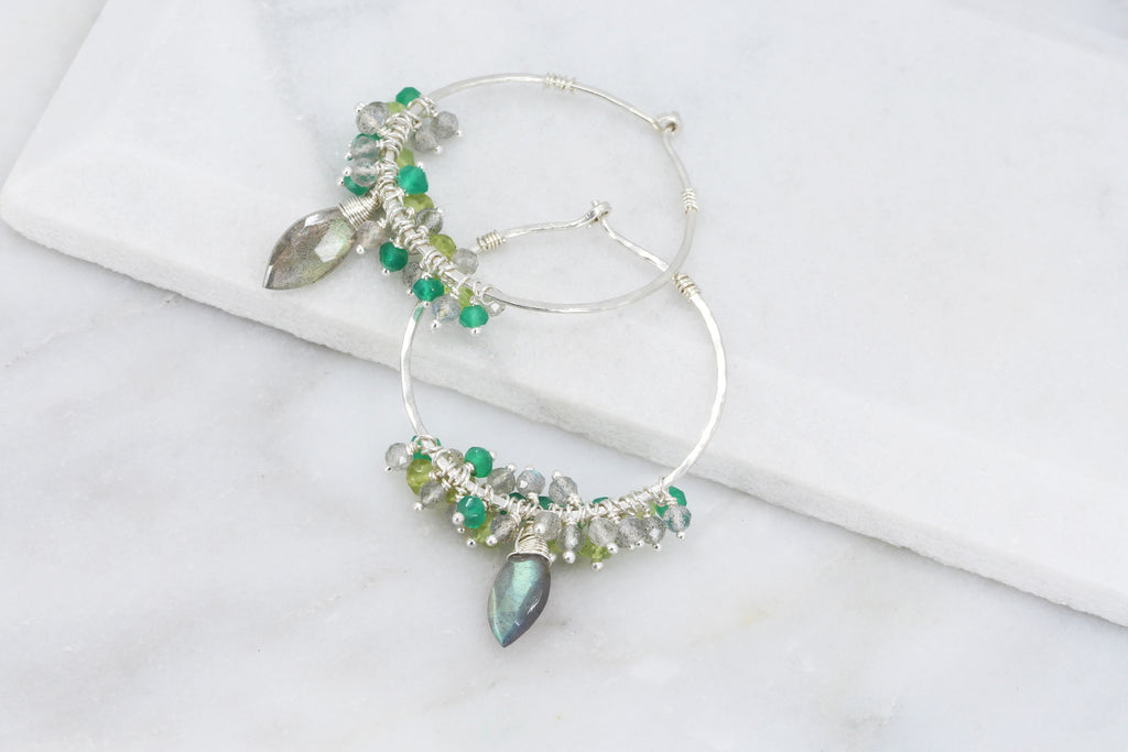 Hammered stering silver hoop earrings with clusters of shimmering faceted bright green onyx, lime green peridot and iridescent labradorite and a central wire wrapped faceted marquise labradorite with amazing flash.t