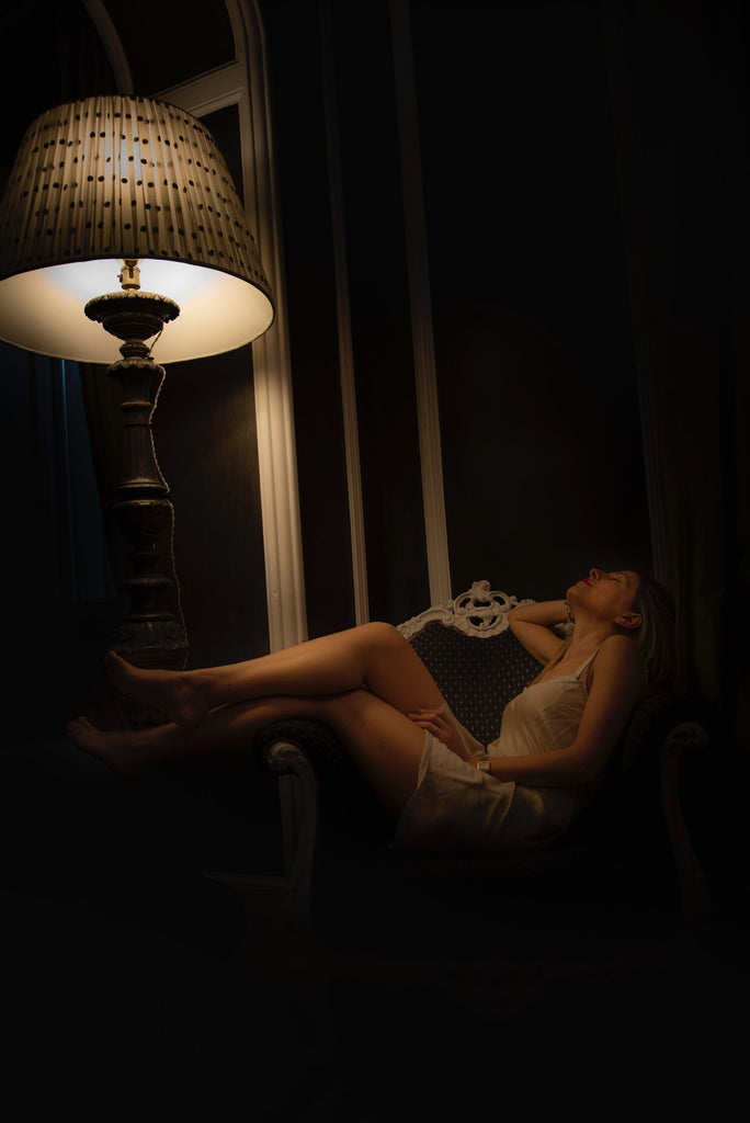 woman sitting in the dark on sex furniture