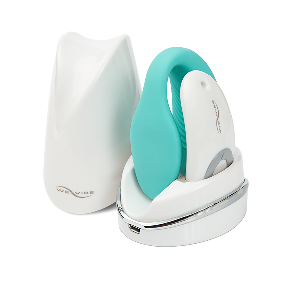 Sync Couple's Vibrator by We-Vibe in blue pictured sitting in charging station
