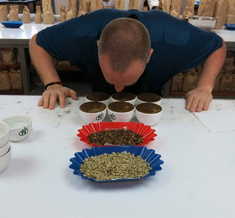 Photo of Jim Pellegrini cupping coffee in Nairobi, Kenya