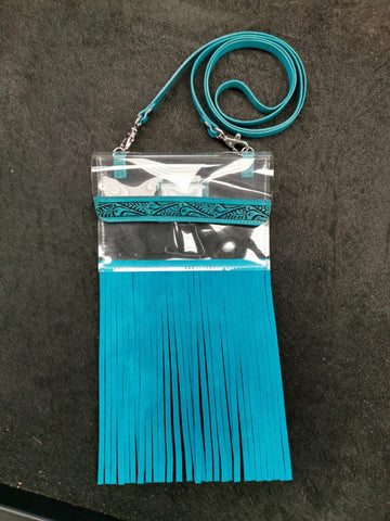 "Clear, crossbody bag w/ fringe, NFR bag policy compliant, antique tooled with matching suede fringe. 4.5"" x 6.5"""