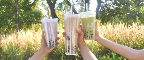 3 people holding up bubble tea in their ReBubble Cups