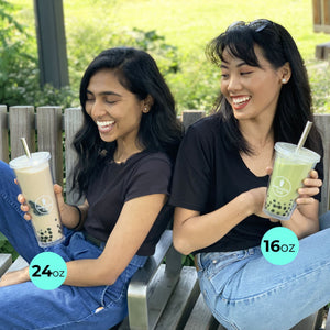Two girls sitting and laughing with their regular and large ReBubble Cups