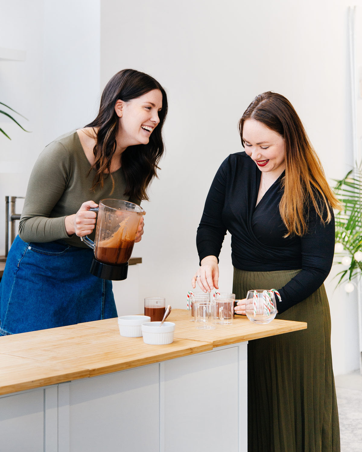 edc680f57 L- Kendra is wearing the Essential Long Sleeve Top in Olive with a denim  wrap around skirt, and black tights. R- Ashley is wearing the Everyday  Twist Top in ...