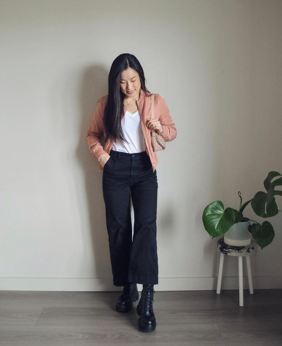 White t-shirt with combat boots and light pink jacket