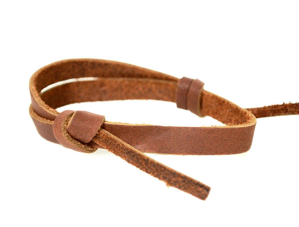 Saddle brown narrow leather wrist band with adjustable slip knot closure