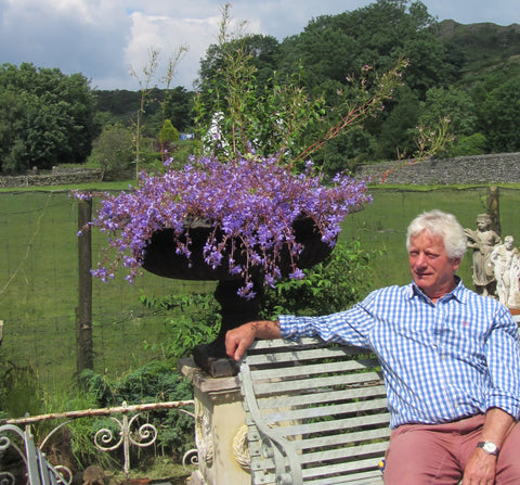 Clive Wilson at yew tree barn, reclaimed bench, cast iron urn lake district reclamation and salvage