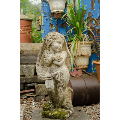 A Cast Stone Sculpture of a Putti