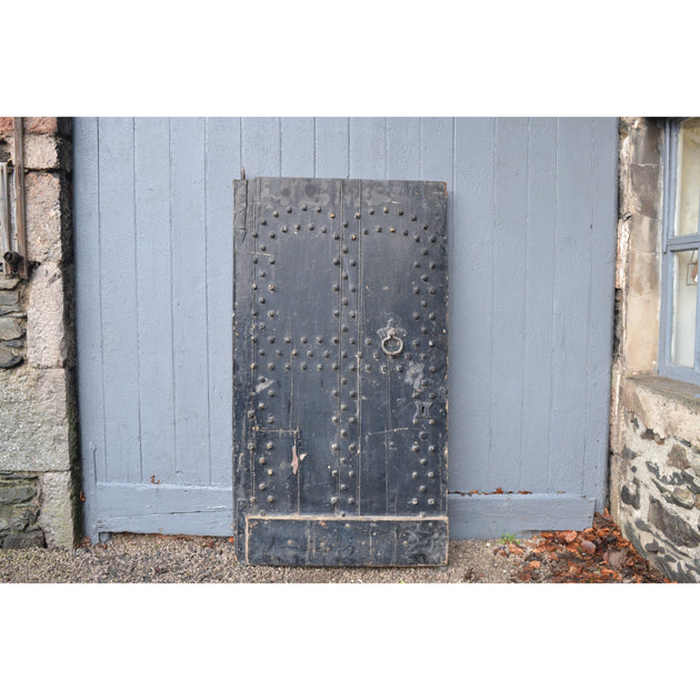 Antique reclaimed studded door. 17th century wooden door
