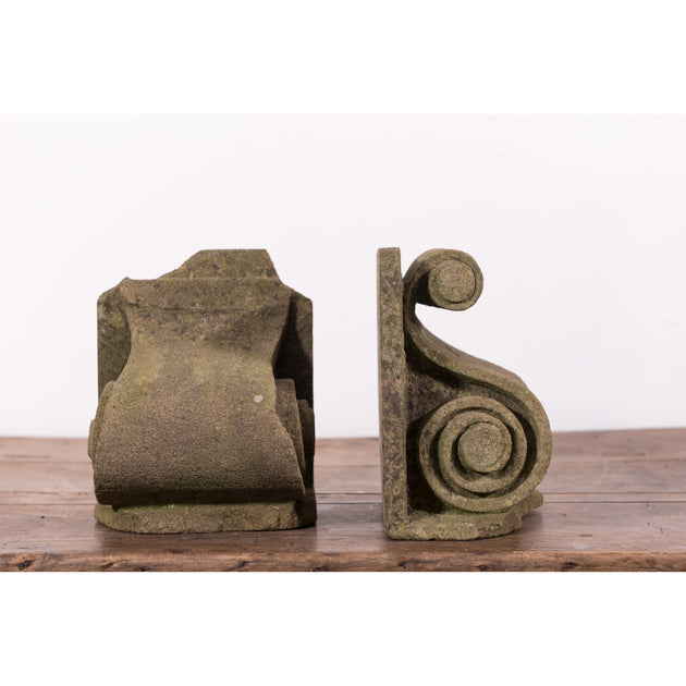 A Pair of Carved Stone Corbel Bookends