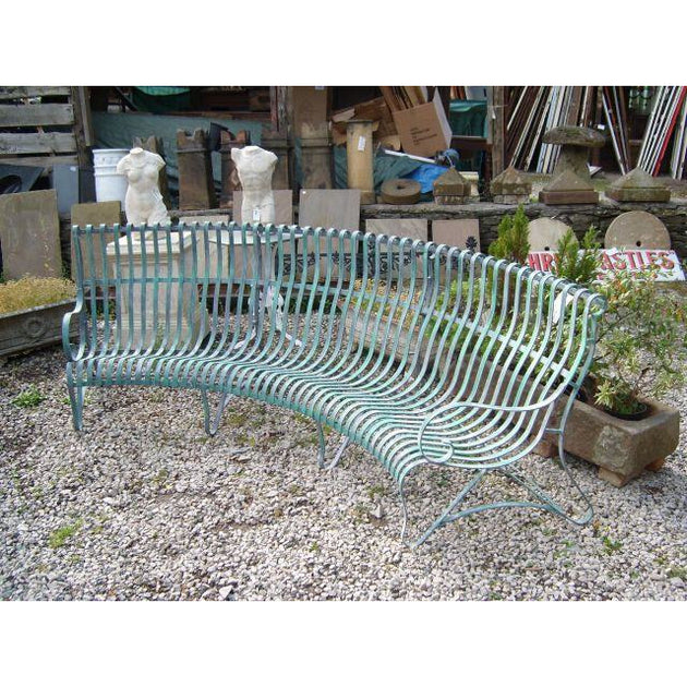 Four seater curved bench verdigris strap work english