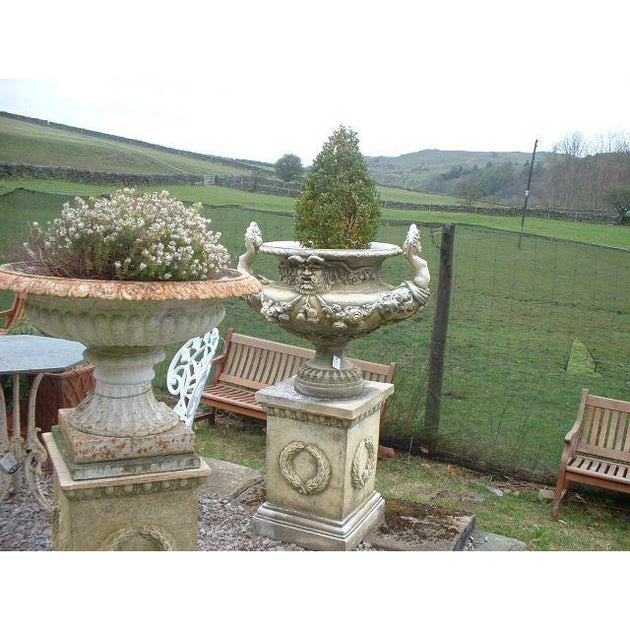 large garden urn on plinth english gardens