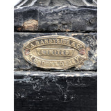 A. Handyside brass makers mark plate on a pair of cast iron urns