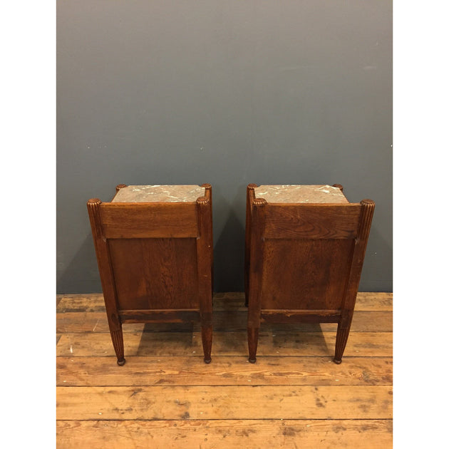 A pair of oak bedside cabinets