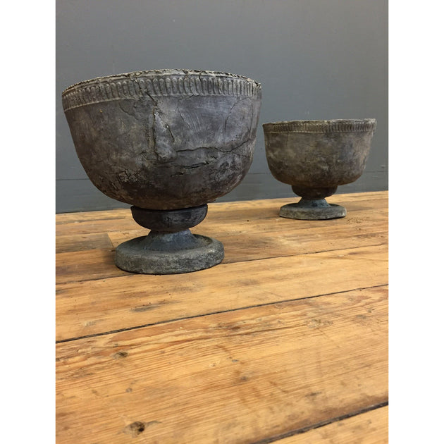 Pair of small lead urns