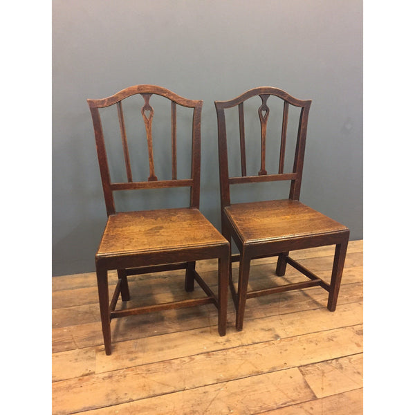 An elegant pair of oak country chairs
