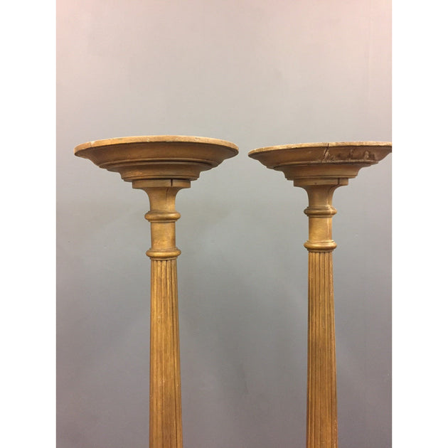 A pair of regency style torcheres