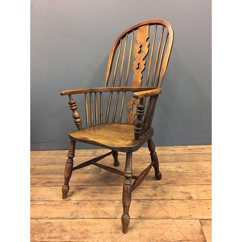 A high backed elm windsor chair