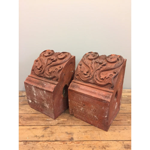 A pair of decorative terracotta corbels