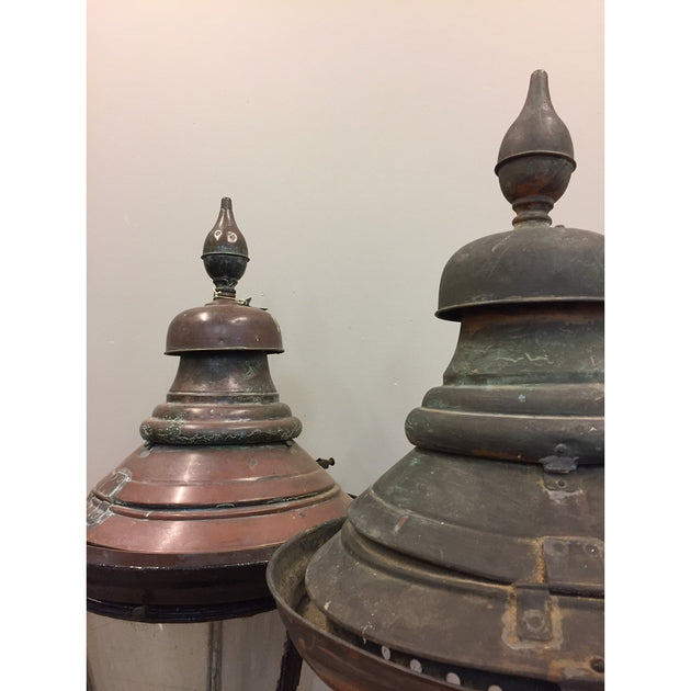 A pair of large copper lanterns