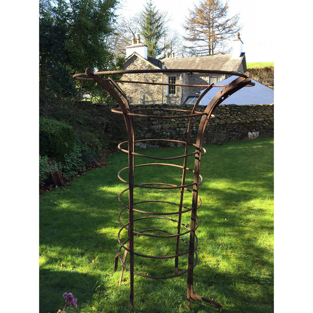 A Pair of Wrought Iron Treeguards