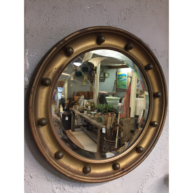 regency style circular mirror with balls. bevelled glass and gold gilding