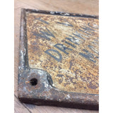 reclaimed cast iron water main marker. salvaged decorative ironwork