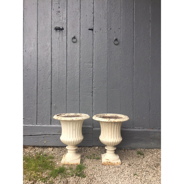 Pair of cast iron campana urns