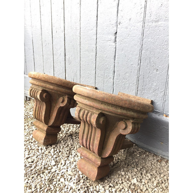 A pair of cast iron corbels
