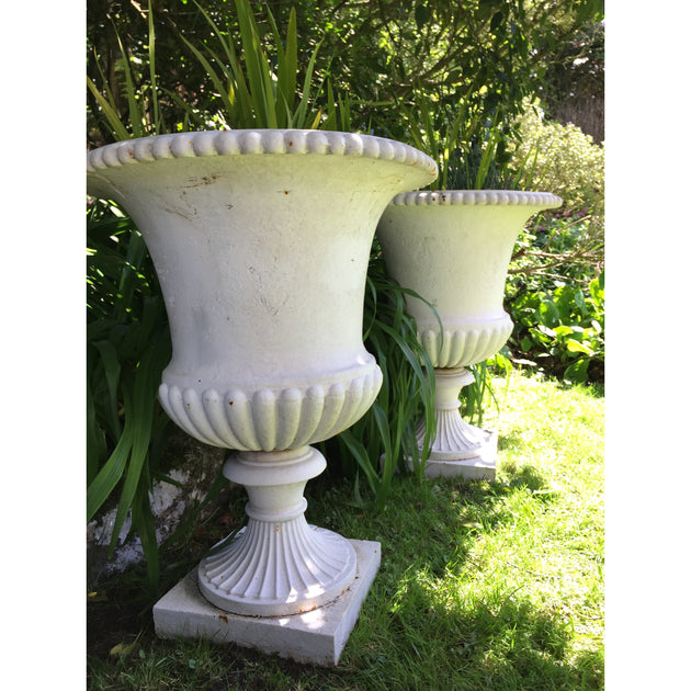 A Pair of Large Cast Iron Urns