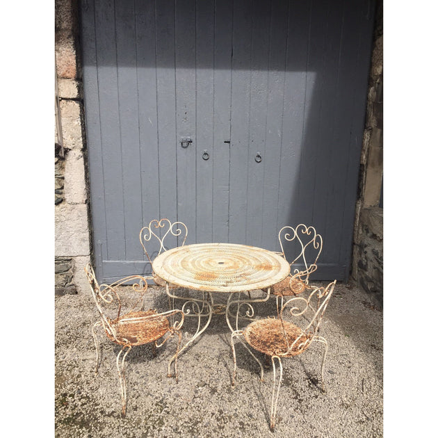 Antique French garden table and four chairs