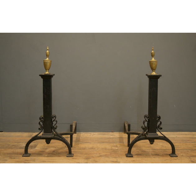 Antique cast iron fire dogs with brass finials