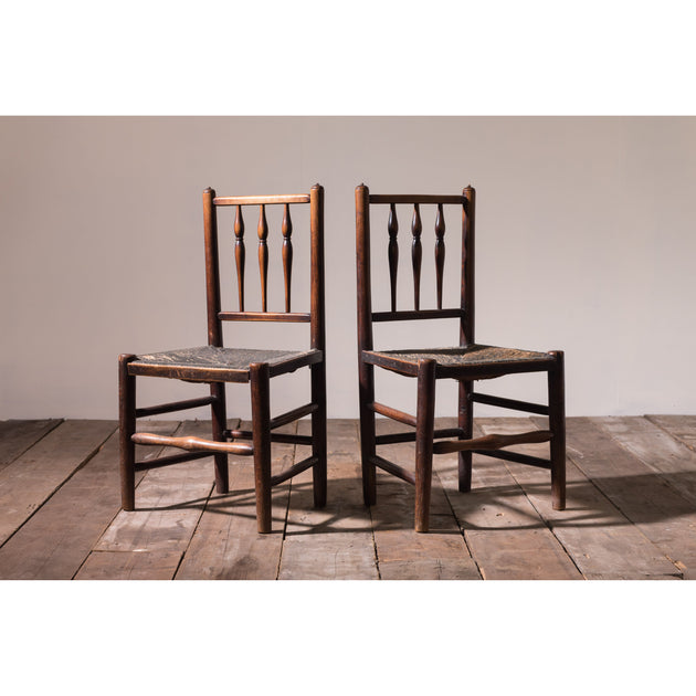 A pair of spindle back 'dales chairs'.