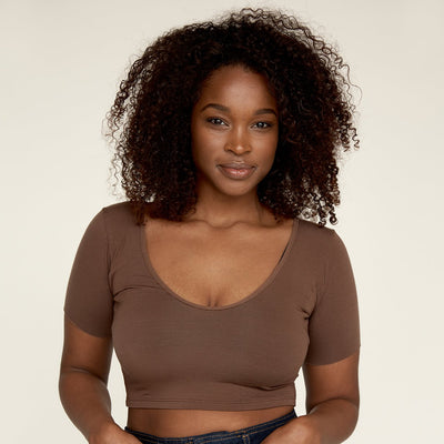 Woman wearing The Crop undershirt from Numi in deep brown