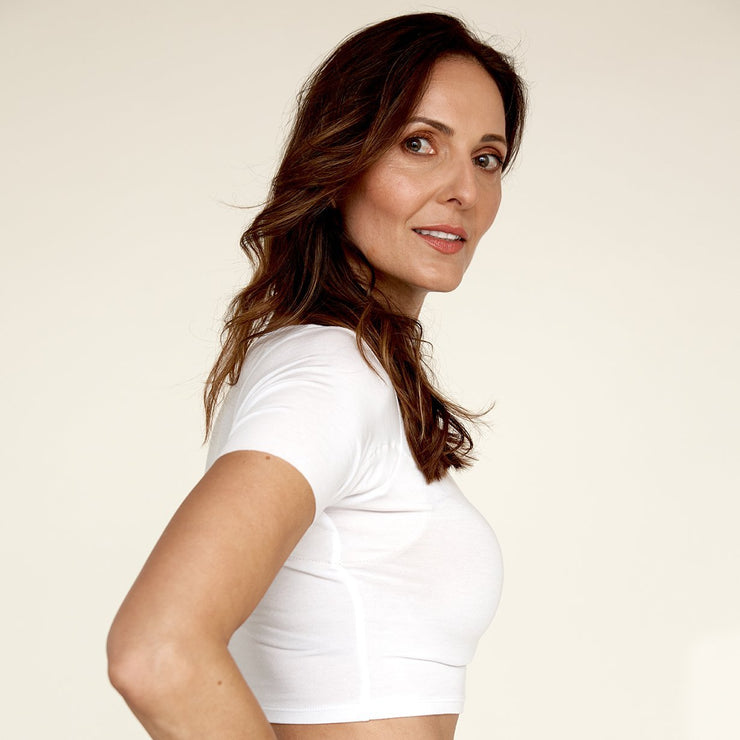 Woman wearing The Crop undershirt from Numi in white while showing the Contemporary Cotton gusset