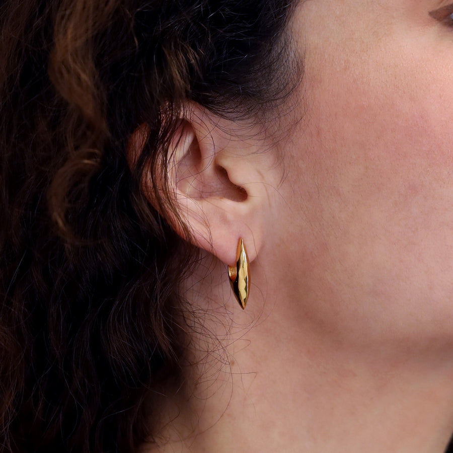 Girl wearing elegant gold plated silver earrings bena jewelry cast edgy jewelry collection montreal made in canada yellow gold plated silver earrings modern shape handmade in Montreal Made in Canada Fine Jewelry Designer