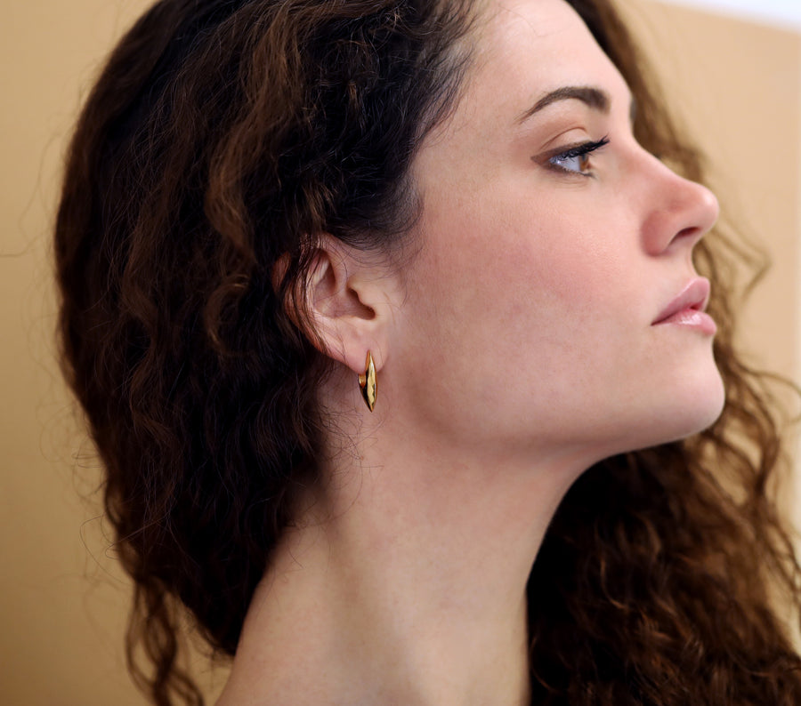 Girl wearing elegant gold plated silver earrings