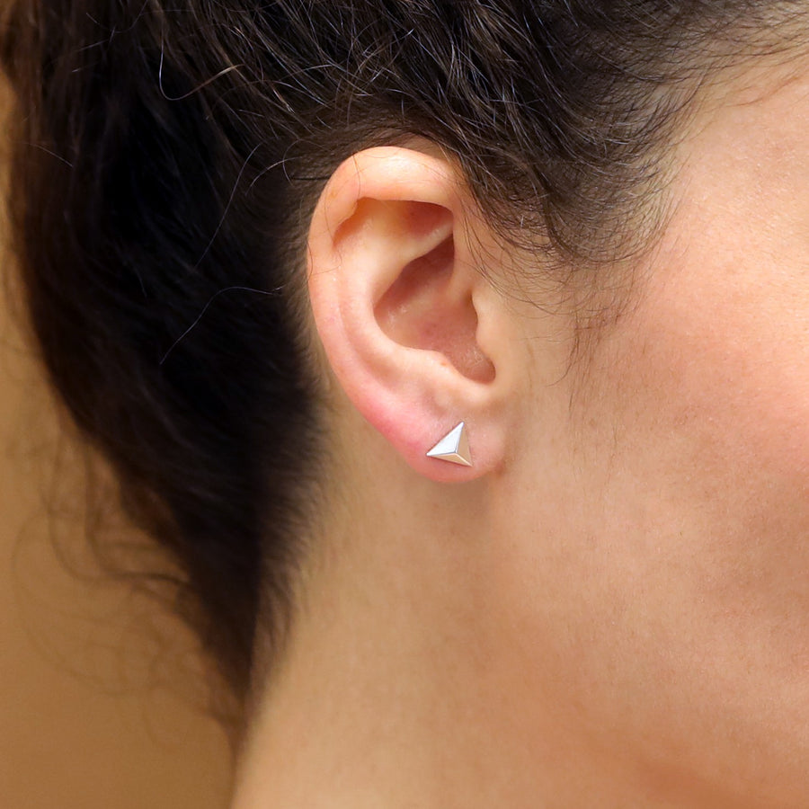 Woman wearing white gold stud earrings small jewelry