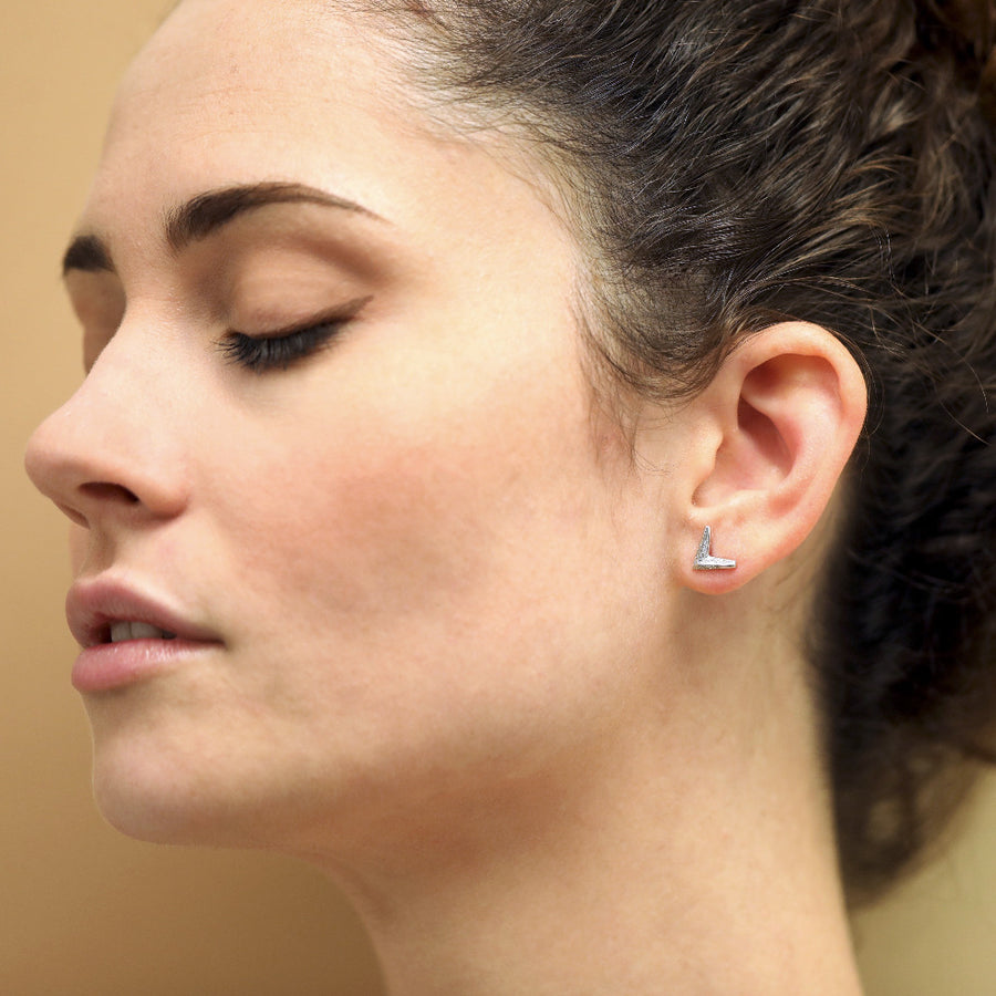 Girl wearing white gold and diamond earrings