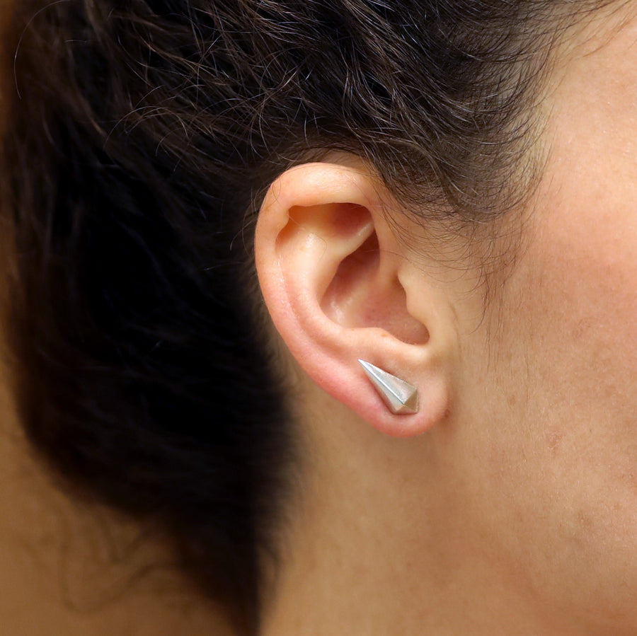Woman wearing elegant small stud sterling silver stud jewelry