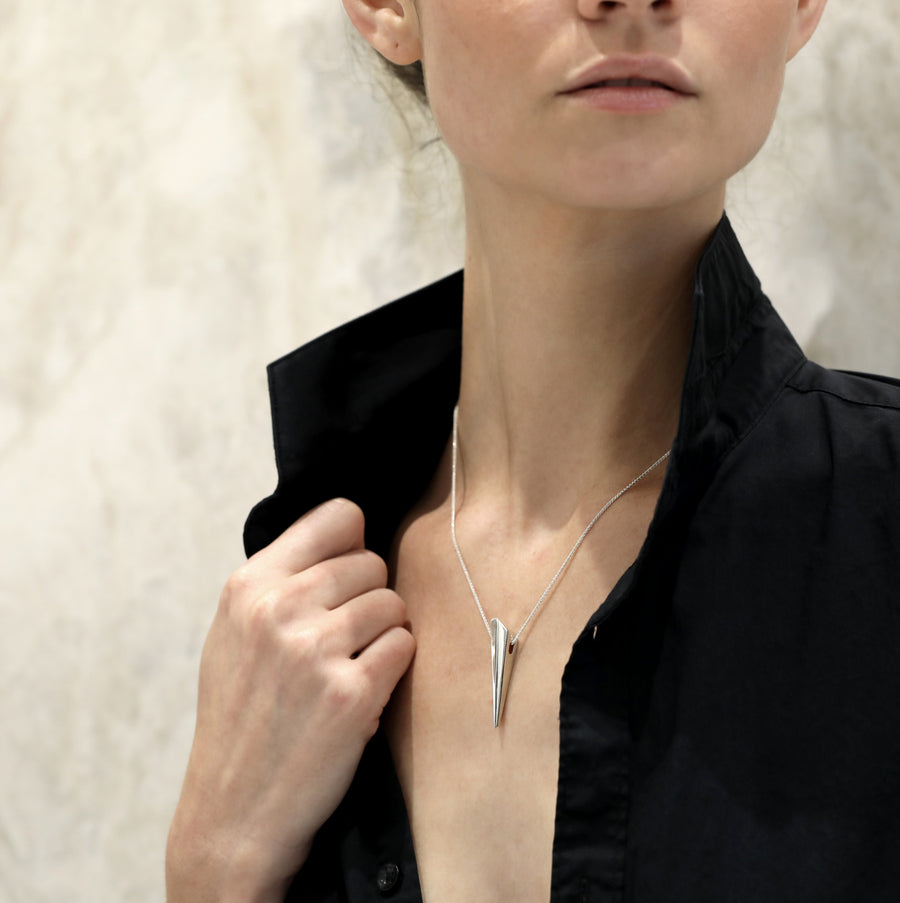 Girl wearing a silver pendant