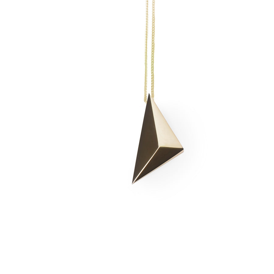 Front view of pyramidal bold vermeil gold unisexe edgy pendant bena jewelry montreal made in canada unisee minimalist simple jewelry design montreal made in canada