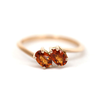 Rose gold toi et moi bridal ring with two orange spessartite garnet gemstone Bena Jewelry Montreal designer Ruby Mardi boutique Made in Canada