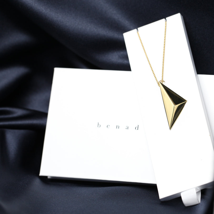 Front view of edgy pyramidal pendant montreal made in canada vermeil gold silver plated jewelry design in the jewelry box packaging custom made in montreal canada fine jewelry design luxury experience