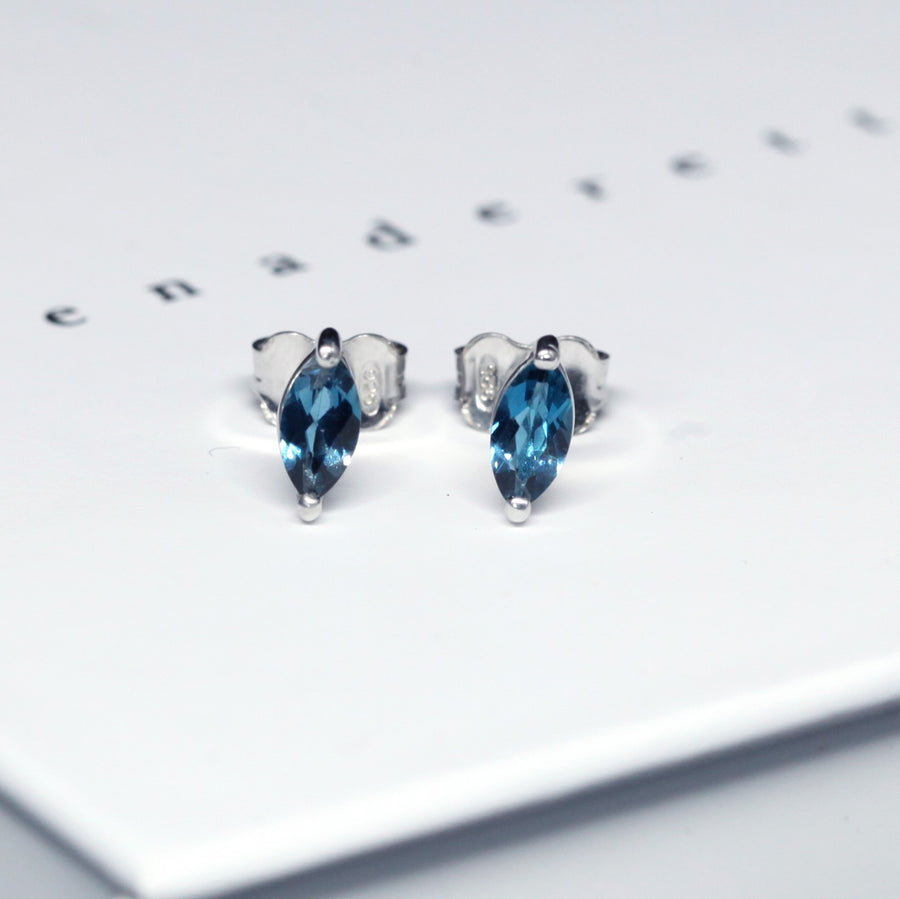 Front view of bena jewelry marquise shape london blue topaz silver earrings handmade in montreal canada custom made color gemstone jewelry specialist little italy montreal jeweler ruby mardi
