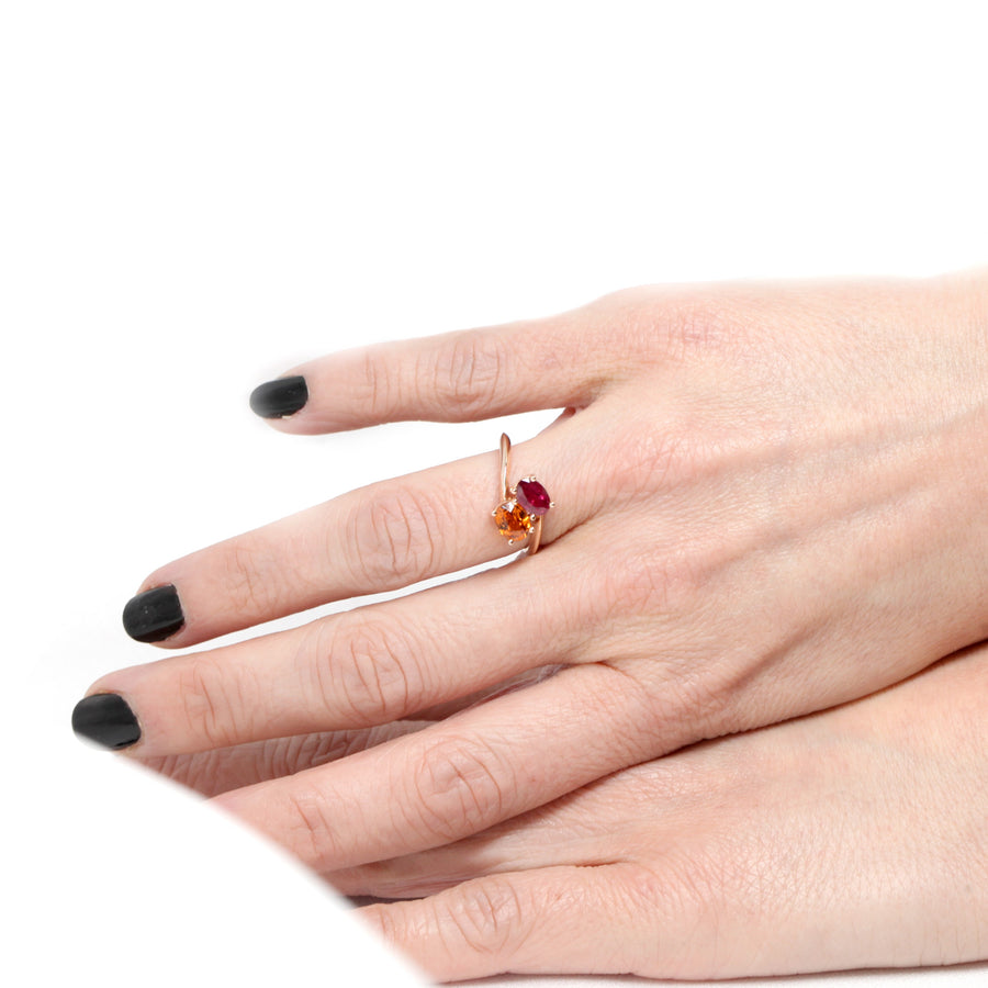 oval shape color gemstone ruby and spessartite garnet rose gold engagement ring toi et moi design made in montreal by bena jewelry fine custom made bridal designer jeweler in little italy montreal