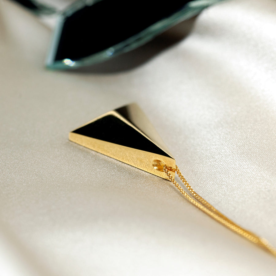 Back view of vermeil gold Edgy collection of Bena Jewelry montreal made simple minimalist pendant gold plated in montreal unisexe bold jewelry ethical custom made bridal and fashion jeweler manufacture montreal made in canada minimalist cool luxury jewelry